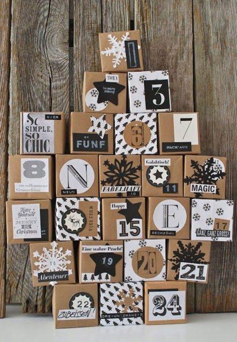 Boîte identique couleur kraft et une décoration noire et blanche pour ce calendrier de l'avent!